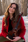 Girl poses with violin Royalty Free Stock Photo