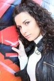 Girl posing against graffiti wall Stock Image