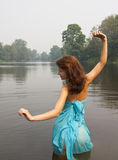 Girl posing against river Stock Photography