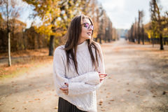 Girl posing  in autumn park Stock Images