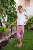 Girl posing with a badminton racket Stock Photo