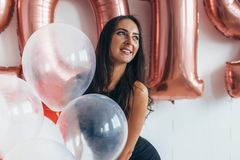 Girl posing with balloons Playing and celebrating Stock Photo