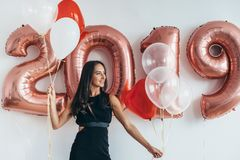 Girl posing with balloons Playing and celebrating Stock Image