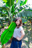 Girl posing with Banana trees. Girl posing with Banana leave and trees.  Smiley happy face Stock Photos