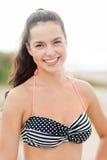 Girl posing on the beach Stock Photos