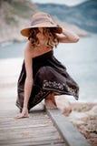 Girl posing on berth Stock Images