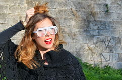 Girl posing with big party sunglasses outdoors Royalty Free Stock Photo