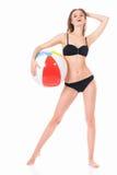 Girl posing in bikini with beach ball Royalty Free Stock Image