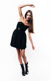 Girl posing in black dress Royalty Free Stock Photography