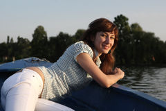 Girl posing on a boat Royalty Free Stock Photography