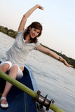 Girl posing on a boat. A young and nice girl on the boat Royalty Free Stock Images