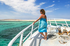 Girl posing on the bow of the yacht in the beautiful sea landsca Stock Photography