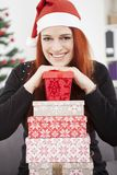 Girl is posing with christmas present Stock Images