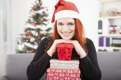 Girl is posing with christmas present Royalty Free Stock Photo