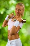 A girl posing with dambbells Stock Photos