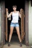 Girl posing at the entrance to a Sallon wild west. Stock Photos
