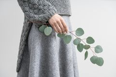 Girl posing with eucalyptus branch Royalty Free Stock Image