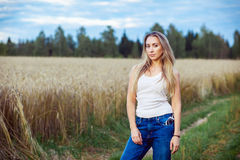 Girl posing in a field at sunset Royalty Free Stock Image