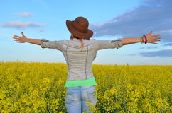 Girl posing in a field of yellow flowers Stock Photos