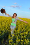 Girl posing in a field of yellow flowers Royalty Free Stock Photo