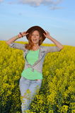 Girl posing in a field of yellow flowers Stock Photography
