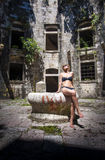 Girl posing in a fortress Mamula. Photo of girl posing in a fortress Mamula Royalty Free Stock Image