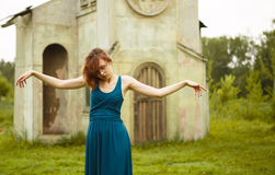 Girl posing in front of little church Royalty Free Stock Images