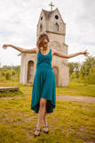 Girl posing in front of little church Royalty Free Stock Photography