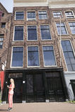 Girl posing in front of original  anne frank house in amsterdam Stock Image