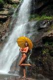 Girl posing in front of waterfalls Stock Image