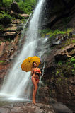 Girl posing in front of waterfalls Royalty Free Stock Images