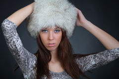 Girl posing in a fur hat Stock Image