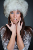 Girl posing in a fur hat Royalty Free Stock Photos
