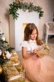 Girl holding Christmas present Stock Photo