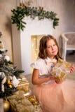 Girl holding Christmas present Stock Photography