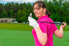 Girl posing  with a golf  club Royalty Free Stock Photo