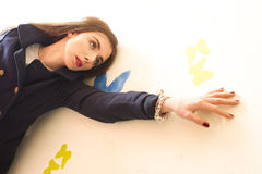 Girl posing on the graffiti wall. Dreaming about butterflies Royalty Free Stock Photos