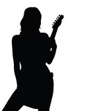 Girl posing with a guitar black silhouette Royalty Free Stock Images