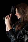 Girl posing with guns Royalty Free Stock Images