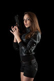 Girl posing with guns Stock Image
