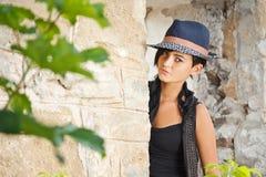 Girl posing in hat stock photo