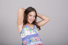 Girl posing with her arms up Royalty Free Stock Photography
