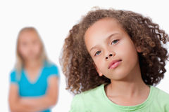 Girl posing with her friend in the background Royalty Free Stock Photo