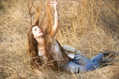 Girl posing in the high grass. Girl posing in very high grass, playing with  her long hair Royalty Free Stock Photos