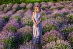 Girl posing in a lavender field stock photo