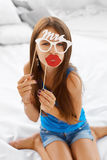 Girl posing with lips and eyeglasses props. Stock Images