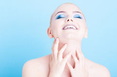Girl posing with matching blue make-up and polish Stock Photos