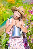 Girl posing with metal watering can shows thumb up Stock Photography