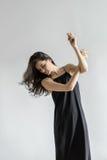 Girl posing in motion in studio Stock Image