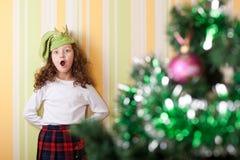 Girl posing near christmas tree Royalty Free Stock Images